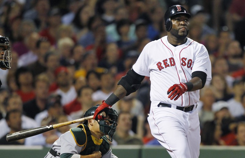 David Ortiz of the Boston Red Sox watches the flight of the ball down the right-field line Wednesday night. It went for a home run – the key hit in a 6-4 victory against Oakland.