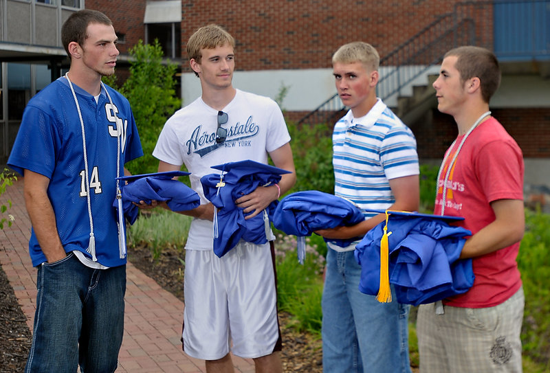 Eddie Warren, left, not only played three sports with two prosthetic legs, but was a co-captain in each sport. The other co-captains, left to right, were Heath Cormier, football; Heath Howell, baseball; and Duncan Mixer, basketball.