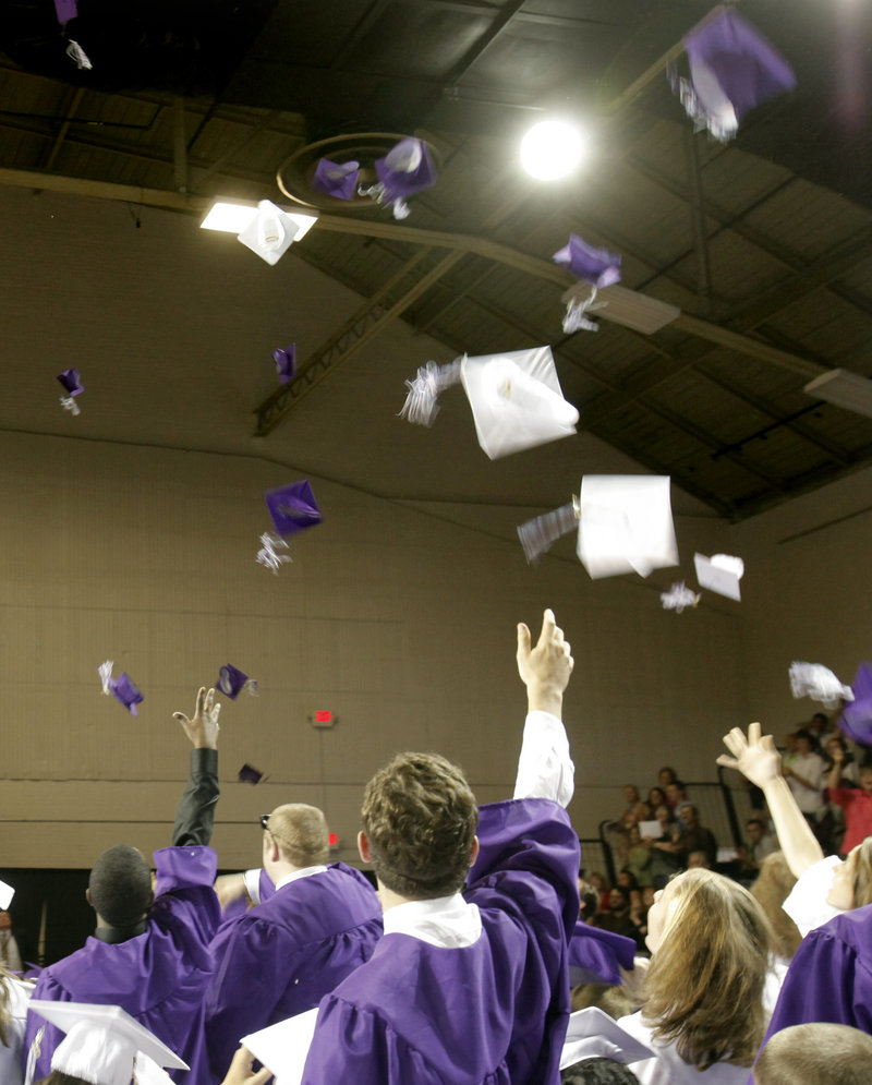 Mortarboards sail toward the roof of the Portland Expo as Deering High School seniors celebrate at the end of their graduation ceremony.