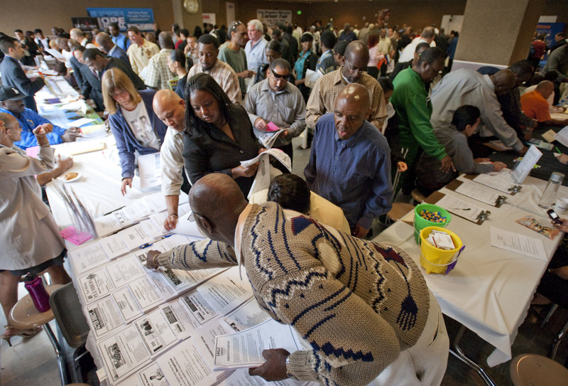 Job seekers gather Thursday at the Los Angeles Mission for the ninth annual Skid Row Career Fair. Economist Mark Zandi expects it to take until 2013 for the economy to create enough jobs to recoup the 8 million positions lost during the downturn.