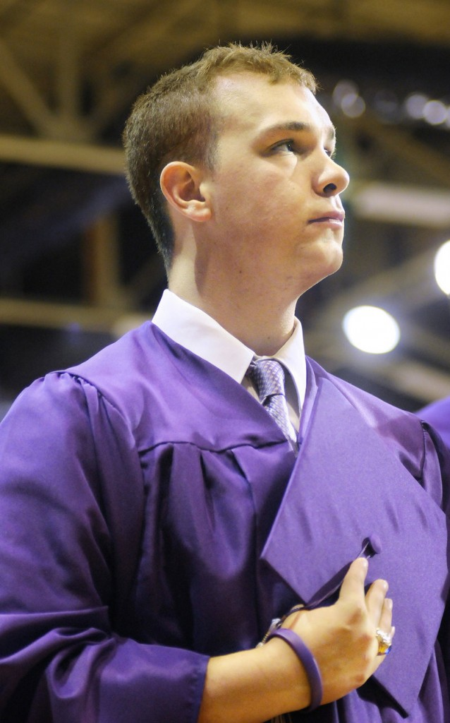 Deering High School senior Matt Caiazzo stands for the national anthem Thursday at the Portland Expo.