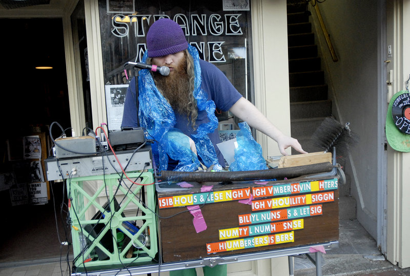 A performer who goes by the name Scott performs with a box of assembled stuff including a file, back scratcher and a chimney sweep.