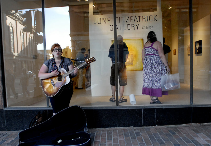 Elizabeth Taillon of Portland performs on the sidewalk outside June Fitzpatrick Gallery during the First Friday Art Walk.