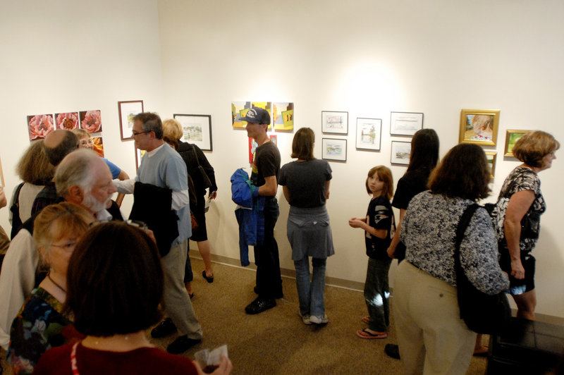 Crowds flock into Bridge Gallery on Congress Street, one of 65 participating in the First Friday Art Walk.