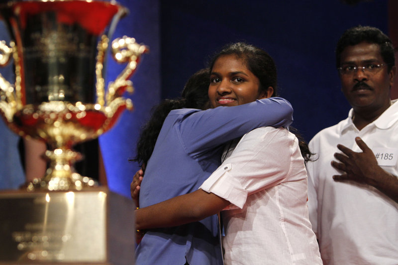 "Anamika Veeramani, 14, of North Royalton, Ohio, is congratulated by her parents Friday after winning the 2010 National Spelling Bee in Washington, D.C. Veeramani correctly spelled the medical word ""stromuhr"" for the victory."