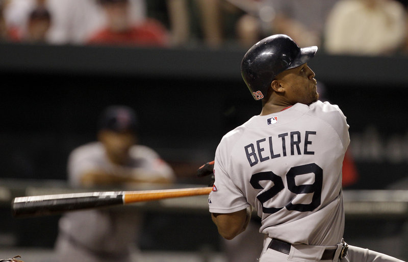 Adrian Beltre watches the flight of his home run Friday night in Baltimore. Marco Scutaro also homered and scored three runs.