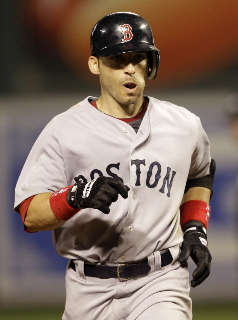 Boston's Marco Scutaro rounds the bases after hitting a solo homer in the eighth inning Friday night. He scored three runs in the 11-0 win.