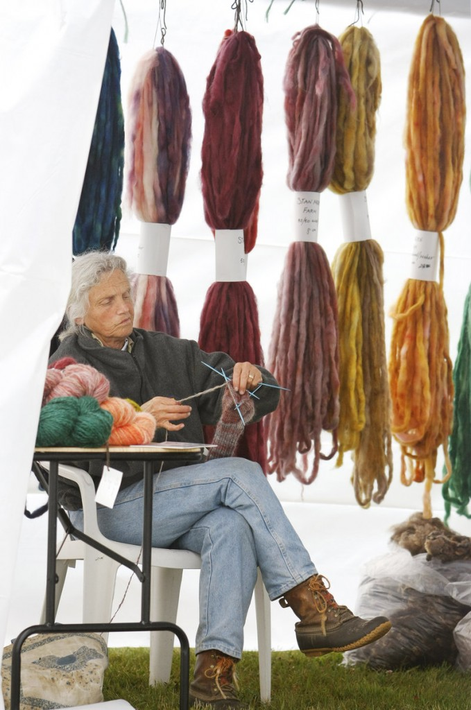 Elaine Graf of Fayette knits with a wool/mohair blend at one of the displays on Saturday.