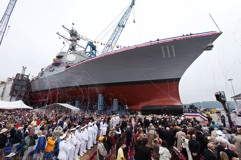 "The USS Spruance looms over the crowd at its christening ceremony on Saturday at Bath Iron Works. The Aegis destroyer's namesake commanded a battle group with two of three U.S. aircraft carriers whose warplanes sank four Japanese carriers at the Battle of Midway, hailed as the turning point in World War II in the Pacific. Adm. Raymond Spruance was remembered by family as a ""mischievous, fun"" grandfather."