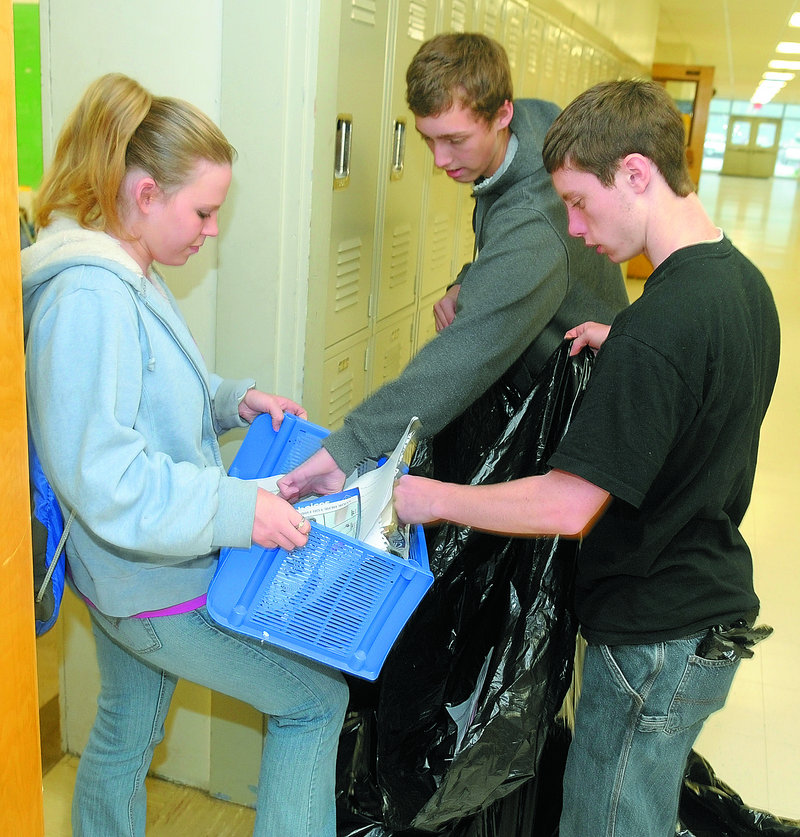 Joe Phelan/Kennebec Journal Two full lines go here plz a Jobs For Maine's Graduates students Tiffany Tardiff, left, Lucien Patten and Nick Colburn collect recyclables Thursday at Hall-Dale High School in Farmingdale.