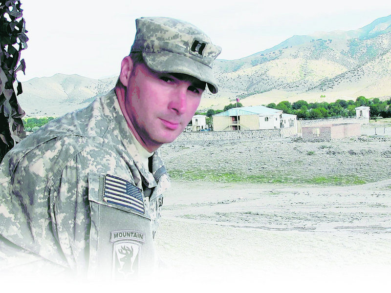 Capt. Paul Bosse of Auburn, who commands the Maine Army National Guard's Bravo Company, stands before an Afghanistan Border Police compound marking the Pakistan border.