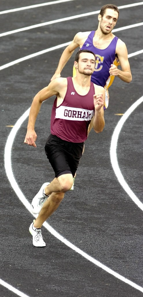 Cam Stevens of Gorham leads Tim Woods of Cheverus around the final turn Saturday and goes on to win the 400 in 50.34 seconds at the Class A state meet at Augusta.