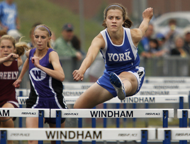 Stephanie Lomasney of York has her eyes on the finish during the 100-meter hurdles. Lomasney finished third in 15.35 seconds. Allison Fereshetian of Leavitt won in 14.72.