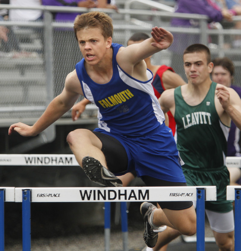 Alec Dunn of Falmouth leads the way in a 110 hurdles heat Saturday. He went on to win the state title in the Class B meet.