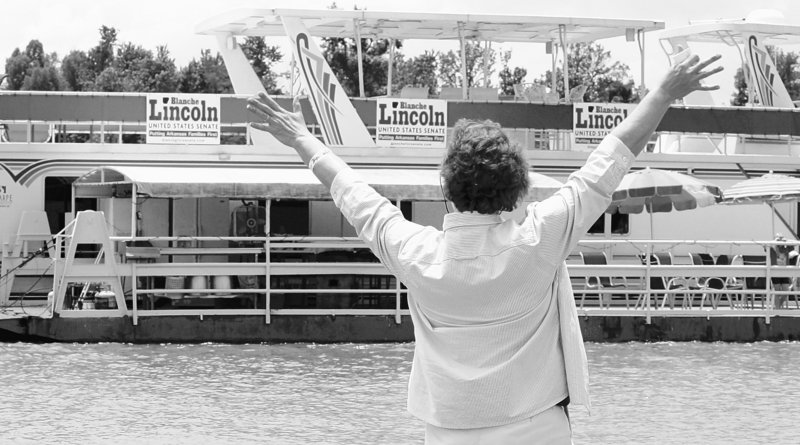 U.S. Sen. Blanche Lincoln, D-Ark., waves to a houseboat displaying her campaign signs on the White River in Jacksonport, Ark., on Saturday. Lincoln faces a primary challenge.
