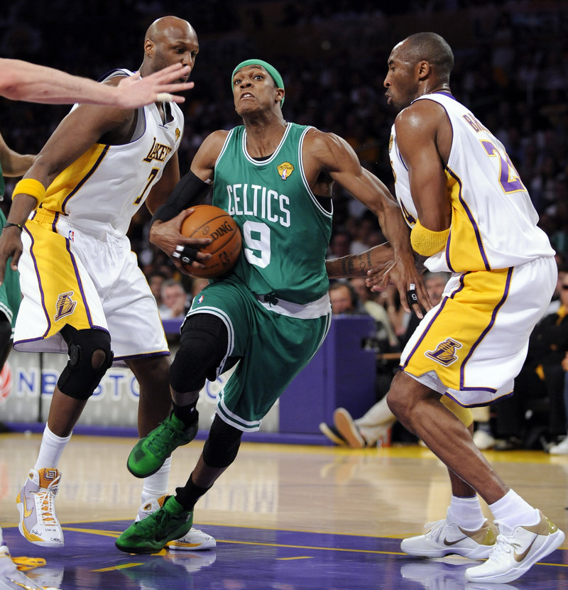 Rajon Rondo drives between Lamar Odom, left, and Kobe Bryant during Boston's 103-94 win Sunday night. Rondo finished with 19 points, 10 assists and 12 rebounds.