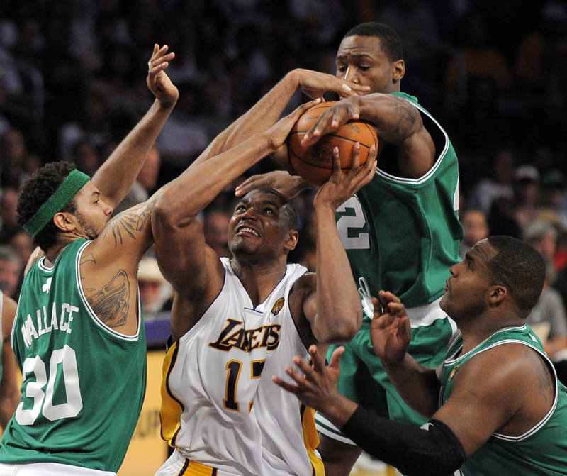 Rasheed Wallace, left, Tony Allen, back, and Glen Davis defend against Lakers center Andrew Bynum during Game 2 of the NBA finals Sunday in Los Angeles. The Celtics tied the series with a 103-94 win, and now head back to Boston for the next three games.