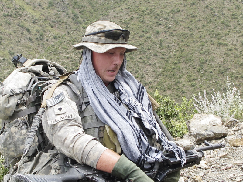 Spc. Jason McFarland of Chelsea takes a break from the uphill climb with his 150-pound load that included a machine gun, tripod, ammunition and other gear.