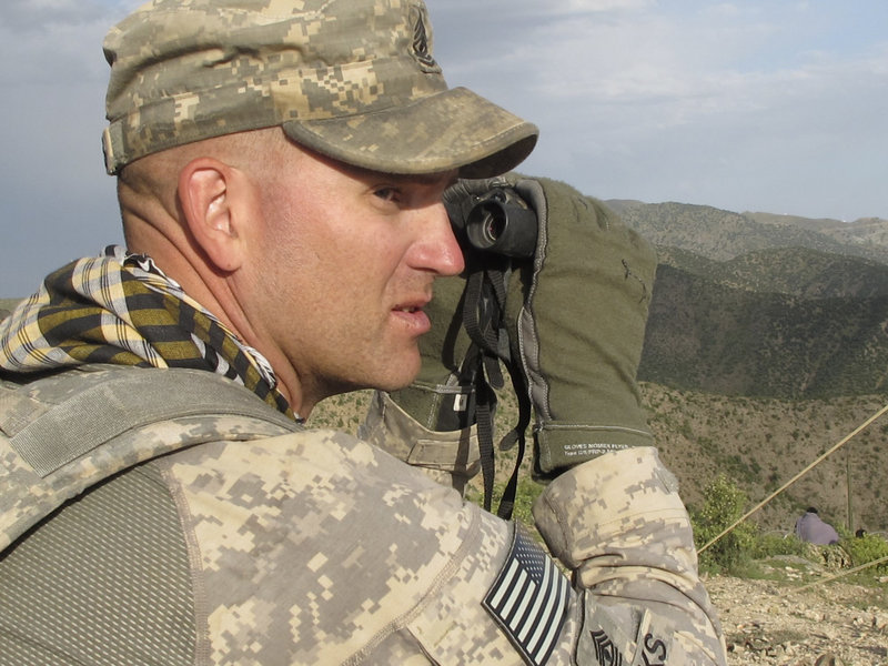 1st Sgt. John Brooks of Glenburn monitors activity in eastern Afghanistan's Pesho Ghar valley from an observation post manned by the Maine Army National Guard.