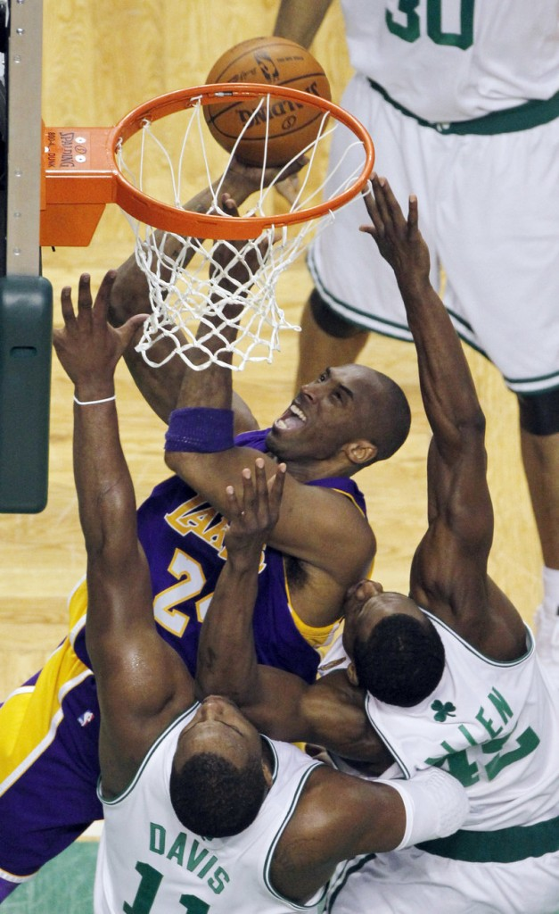 Kobe Bryant of the Los Angeles Lakers finds room to shoot Tuesday night against Glen Davis and Tony Allen of the Boston Celtics. Bryant scored 29 points in a 91-84 victory.