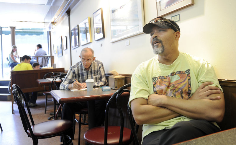 """Eric Thomas, seen at Jorgensen's Cafe in Waterville, is the Colby College band director. He's not convinced Lepage's blunt style will be effective, he said, because some complex issues """"need subtlety."""""""