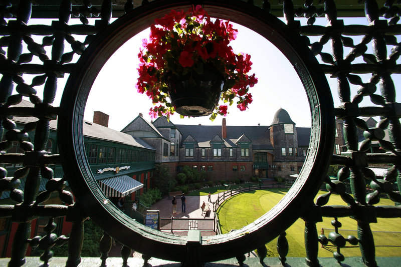 The International Tennis Hall of Fame & Museum in Newport, R.I., is seen through a trellis.