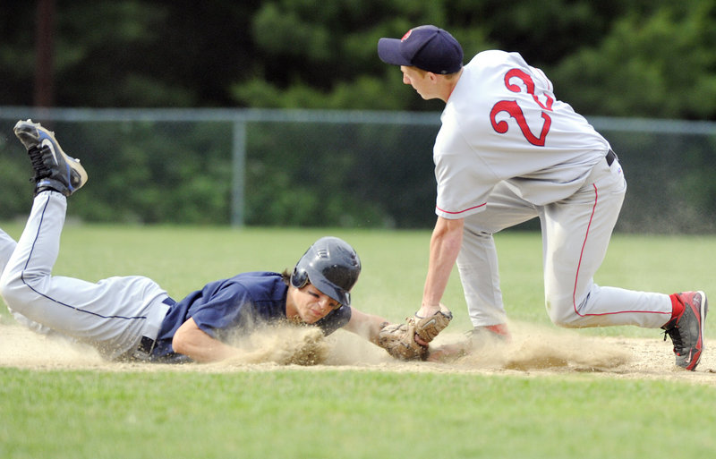Campbell Belisle-Haley of Yarmouth dives back to second base as Jack Martell of Gray-New Gloucester takes the pickoff throw Wednesday. Yarmouth won, 8-6.