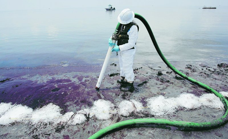 Workers remove oil from the Gulf spill in Pass a Loutre, La. In its response plans, BP said it could marshal enough boats to prevent oil from a deep-water spill from reaching shore.