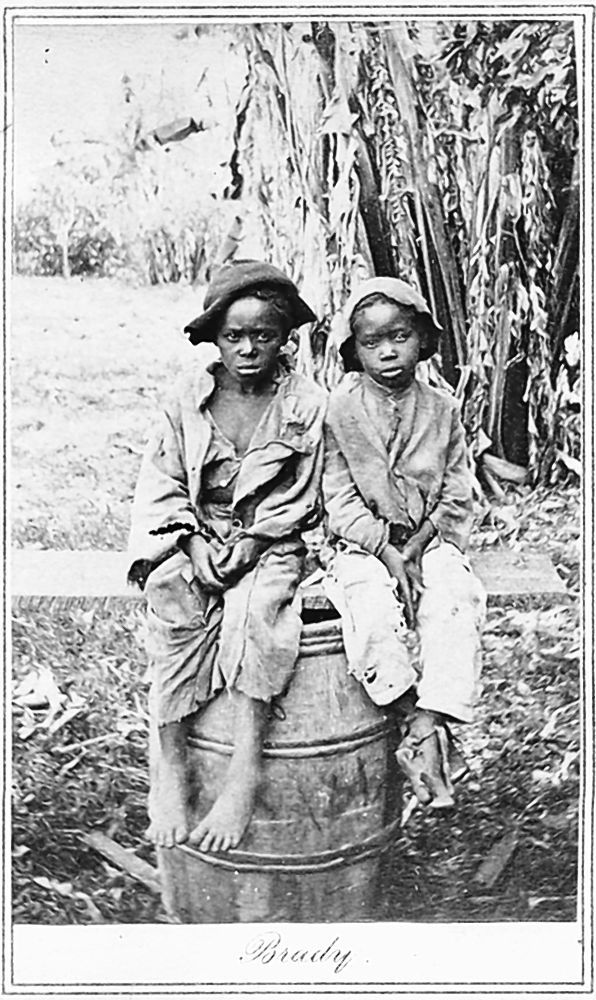 This rare photo, found at a moving sale in Charlotte, N.C., shows two slave children, historians say. An accompanying document detailed the sale of one boy for $1,150 in 1854.