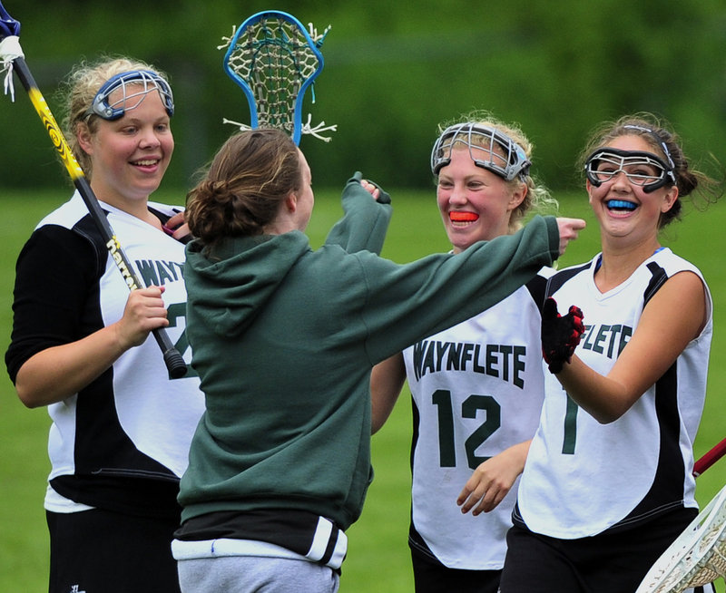 There was plenty to celebrate Thursday for the Waynflete girls' lacrosse team. Included in the celebration were Liz Lewis, left; Lucy Crane, 12; and Mica Thompson, right.
