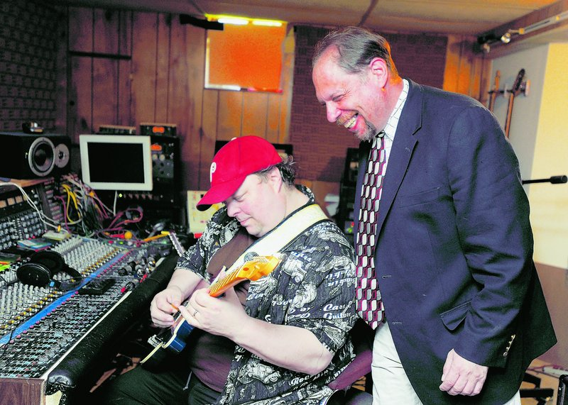 Richard Siegel, right, records a political satire song at a recording studio in Laurel, Md., with the help of Garrick Alden, a music engineer and producer. Siegel is a comedian and comedy club promoter whose income was halved in the recession.