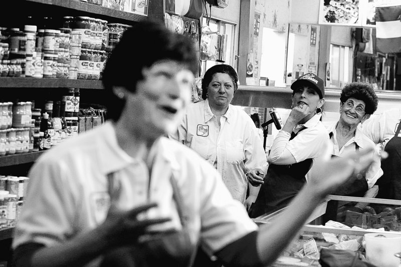 Rosemarie Lippman, left, speaks to a camera, as other workers watch, during the making of a commercial for Claro's Italian Market in San Gabriel, Calif. With new technology available, commercials can be produced at reduced costs, putting them in reach of small businesses.