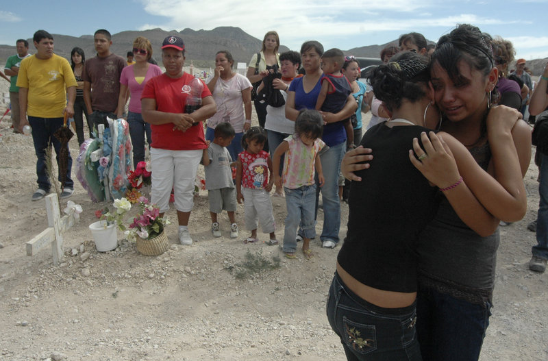 Mourners embrace at the funeral Thursday of Sergio Adrian Hernandez Huereka in Ciudad Juarez, Mexico. The 15-year-old was killed by a bullet fired across the border by a U.S. agent.