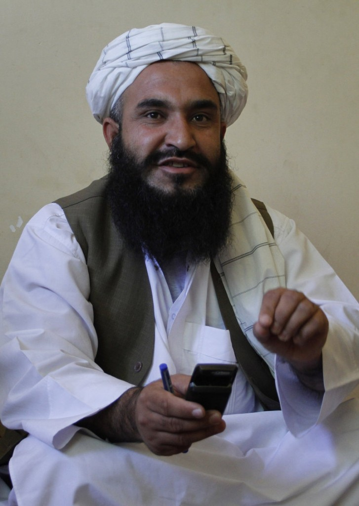 Mullah Gul Ahmad Ahmadi, a member of the governing council of Nimroz province, speaks during an interview in Kabul, Afghanistan. After death threats and an armed attack that killed a colleague, members of the governing council of the remote province have fled to Kabul.