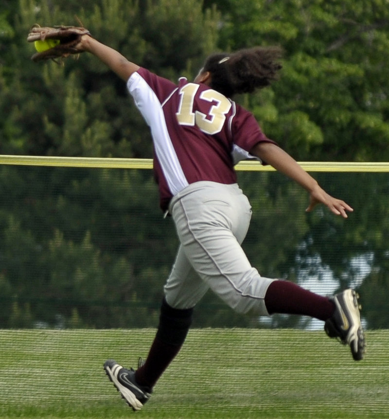 Kristin Duross of Thornton Academy makes a lunging grab of a liner in left field headed for extra bases, helping to squelch a Cheverus rally in the first inning of a Western Class A quarterfinal Friday. Thornton advanced with a 5-2 win.