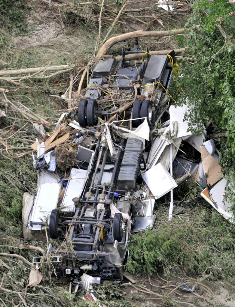 A camper lies overturned after being washed downstream from the Albert Pike Recreation Area by Friday's flooding.