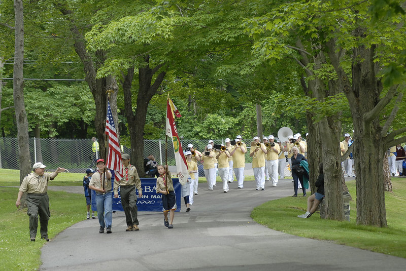 The Family Fun Day parade makes its way into Fort Williams Park Saturday, led by members of Boy Scout Troop 30, including from left, A.J. DiNinno, a troop committee member, and Timmy DiNinno, 14; Brendan Stewart, 17; and Jack Misterovich, 11, all of Cape Elizabeth. The Alumni Band follows the Scouts.