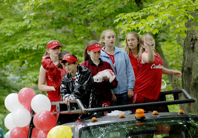 Members of the Cardinals softball team ride in the Family Fun Day parade.