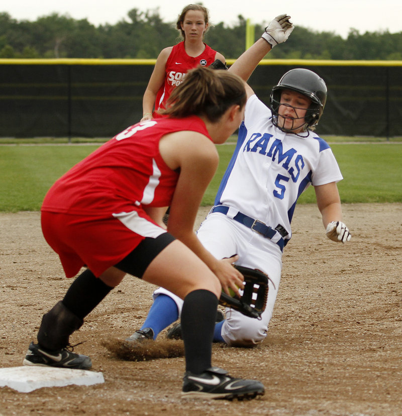 Amanda Linscott of South Portland has the ball and prepares to tag Rachel Magalski of Kennebunk, who was out trying to steal third Saturday. South Portland won, 7-4.