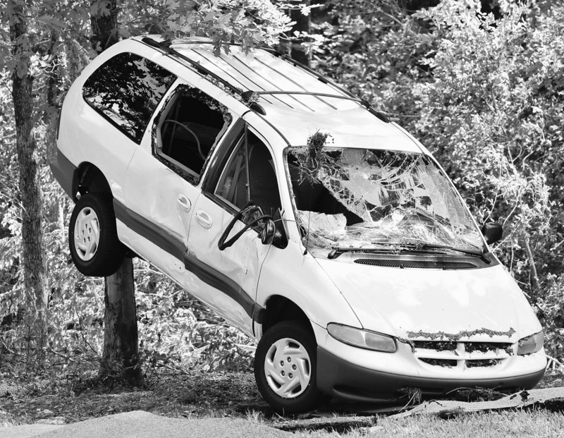 A van sits propped against a tree at Albert Pike campground near Caddo Gap, Ark., on Saturday.