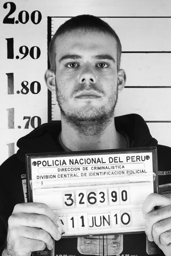 Dutch citizen Joran van der Sloot holds his inmate number before being transferred to a prison in Lima, Peru. After requesting isolation, he now shares a cellblock with a reputed Colombian murderer-for-hire.