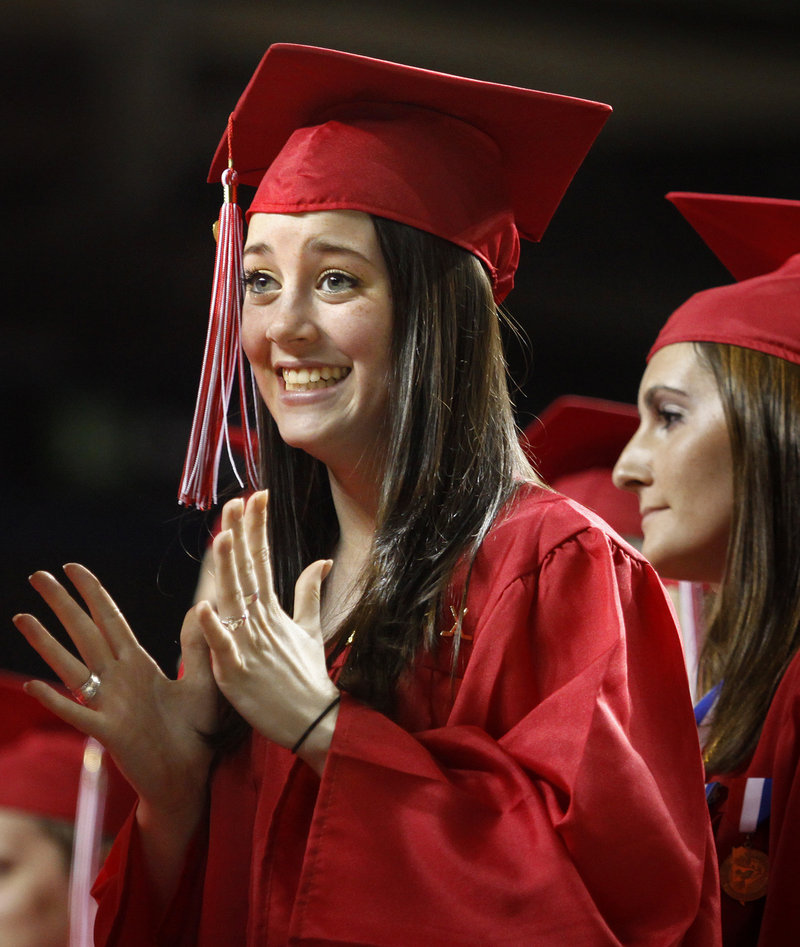 Rebecca Bragg tries to contain her excitement before receiving her diploma during Scarborough High School's commencement exercises on Sunday.