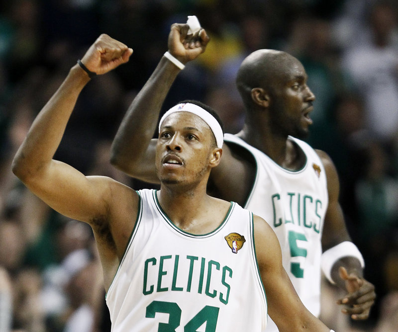"""Paul Pierce, front, and Kevin Garnett celebrate the Celtics' 92-86 win over the Lakers in Game 5 of the NBA finals Sunday night in Boston. Pierce, who scored 27 points, said, """"We've got to get one (win). We're too close to our goal. We've got to get one."""" Game 6 is Tuesday."""