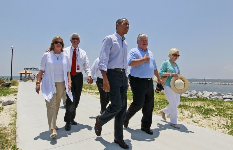 President Obama walks with Mississippi Gov. Haley Barbour, second from right, and Gulfport Mayor George Schloegel, second from left, after meeting with residents affected by the BP Deepwater Horizon oil spill on Monday in Gulfport, Miss. Peggy Schloegel, the mayor's wife is at left, Marsha Barbour, the governor's wife is at right.