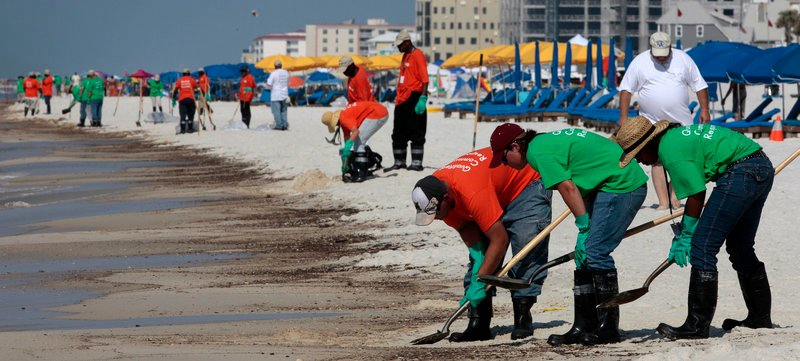 Workers hired by BP clean oily deposits from the shoreline recently in Orange Beach, Ala. The Gulf of Mexico spill reinforces the recent Wall Street lesson that free enterprise needs regulation, a reader says.