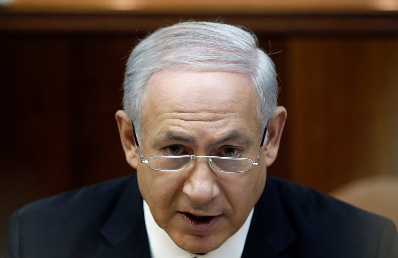 Israeli Prime Minister Benjamin Netanyahu speaks during a Cabinet meeting in Jerusalem Monday. Israel's Cabinet approved an inquiry into its bloody interventionof a Gaza-bound flotilla.