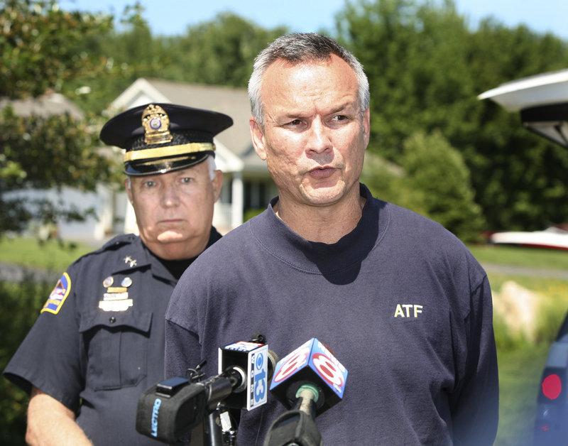 ATF special agent Glen Anderson, right, and Old Orchard Beach Police Chief Dana Kelley address the media in Scarborough after the ATF raid.