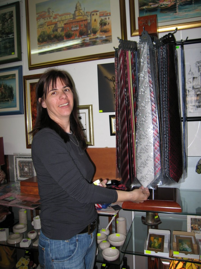 A saleswoman points to a tie at a shop in Sibenik, Croatia.