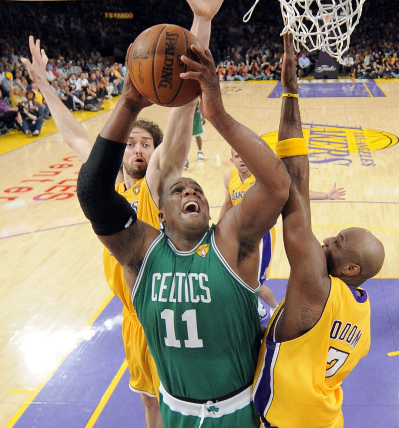 Glen Davis of the Boston Celtics finds room between Lamar Odom, right, and Pau Gasol of the Los Angeles Lakers. Davis played 27 minutes without scoring, receiving extra minutes when Kendrick Perkins was sidelined with a sprained knee.