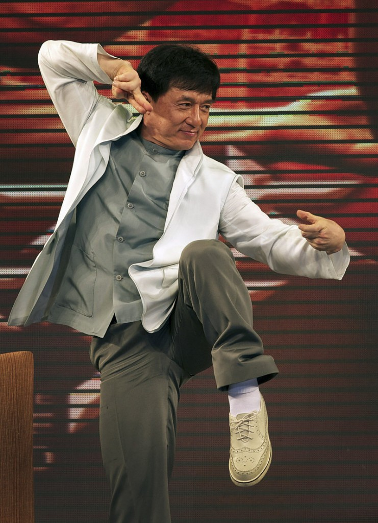 "Actor Jackie Chan strikes a martial arts pose on stage while promoting the new movie ""The Karate Kid"" in Beijing Wednesday. Chan played Mr. Han, a role similar to the Mr. Miyagi character in the 1984 original."